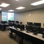 Computers on desks in the HDL room space available to rent