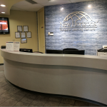 Front desk with New Horizons logo